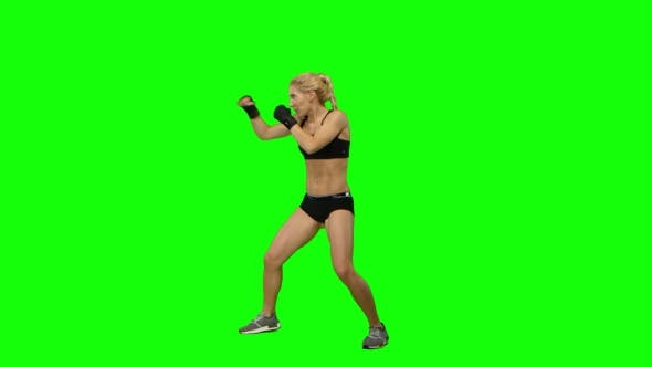 Thumbnail for Girl Kickboxer Wearing Gloves Practicing for Competitions. Green Screen. Side View