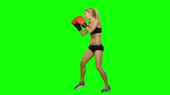 Thumbnail for Girl Kickboxer in a Special Form of Training for Competitions. Green Screen. Side View
