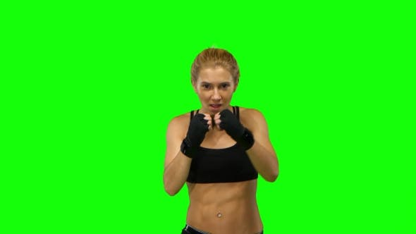 Thumbnail for Boxer Standing in the Front and Sends Butted an Opponent Standing on the Spot. Green Screen.