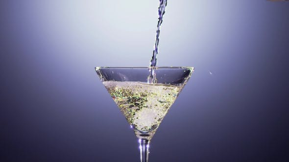 Thumbnail for Alcohol Beverage Is Poured Into Tall Martini Glass.
