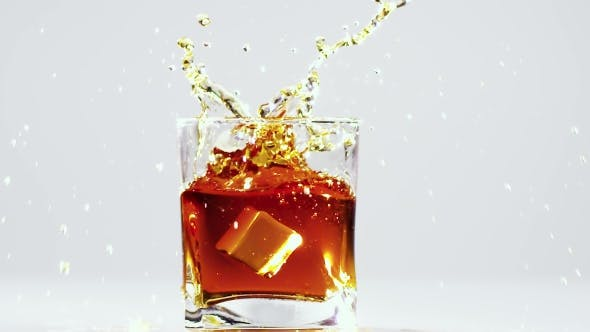 Thumbnail for Two Ice Cubes Falling Into Glass with Brandy.