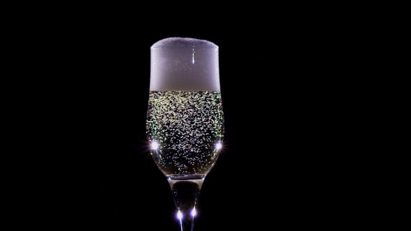 Thumbnail for Bubbles of Champagne Wine Sparkling in a Glass.
