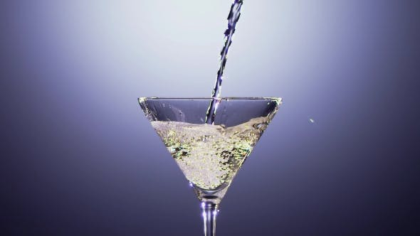 Thumbnail for Alcohol Drink Is Poured Into Tall Martini Glass.