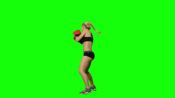 Thumbnail for Boxer Standing in the Front and Make Swings and Kicks. Green Screen. Side View