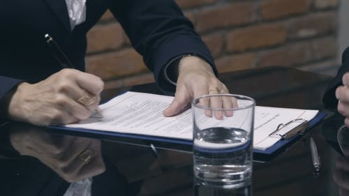 Businesswoman Signing Job Contract with Candidate