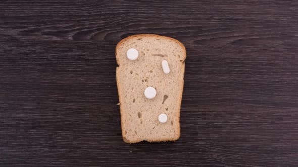 Thumbnail for A Piece of Bread with Pills