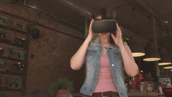 Thumbnail for Woman Uses a Virtual Reality Glasses in Cafe