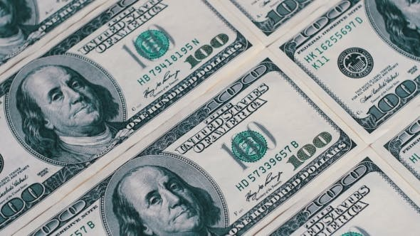 Thumbnail for American Money Dollars on Rotating Surface Background