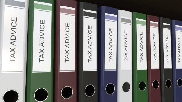 Line of Multicolor Office Binders with Tax Advice Tags
