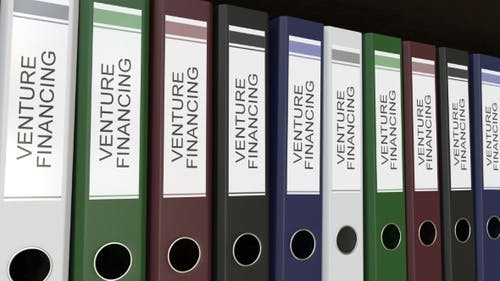 Line of Multicolor Office Binders with Venture Financing Tags