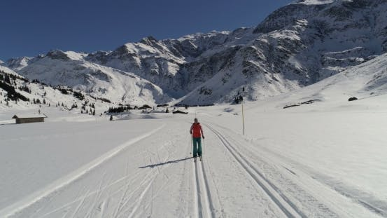 Thumbnail for Woman Cross Country Skiing on Groomed-trail