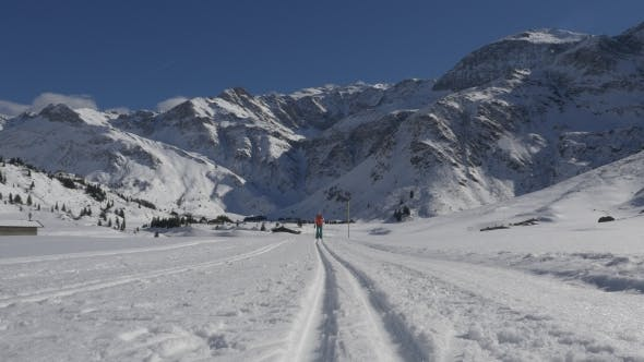 Thumbnail for Fit Woman Crosscountry Skiing on Highlands