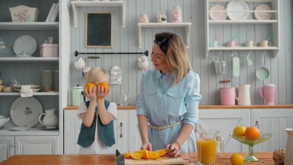 Thumbnail for Beautiful Happy Mother and Child Boy in Kitchen Smiling