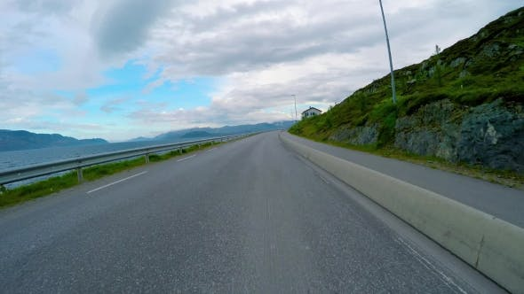 Cover Image for Driving a Car on a Road in Norway