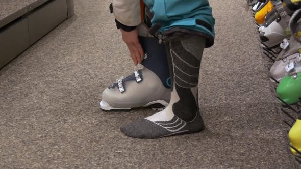 Thumbnail for Woman Tries on Ski Boots in Ski Rental