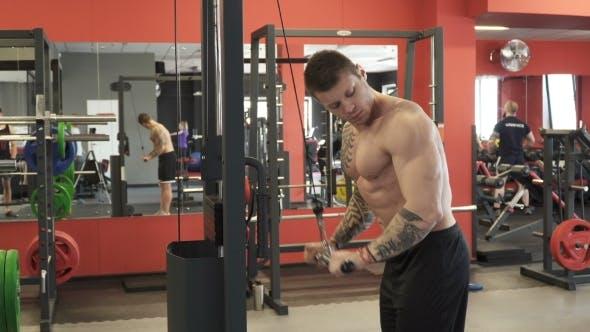 Thumbnail for Man Doing Triceps Pull