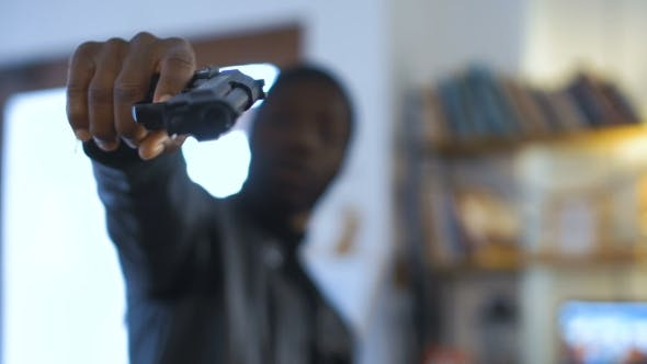 Thumbnail for The Robber Aiming with the Gun