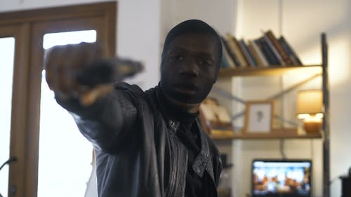 The Robber Aiming with the Gun
