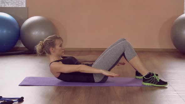 Thumbnail for Attractive Girl Doing Physical Exercises for Core