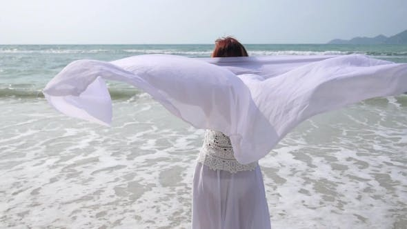 Thumbnail for Lifestyle: Middle-Aged Female in White Clothes on Beach