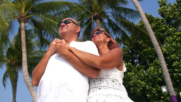 Thumbnail for Senior Couple On Beach Enjoying Vacation on Island