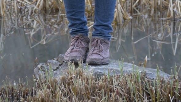 Female Legs Standing Near Pond