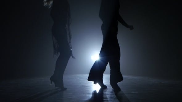 Thumbnail for Dance Couple Demonstrating Magnificent Choreography of Quickstep, Black Background. Close-ups