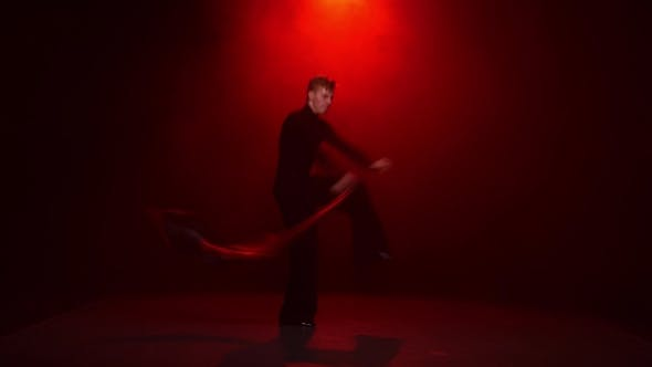 Thumbnail for Man Is Dancing Solo with Red Black Cloth. Red Background