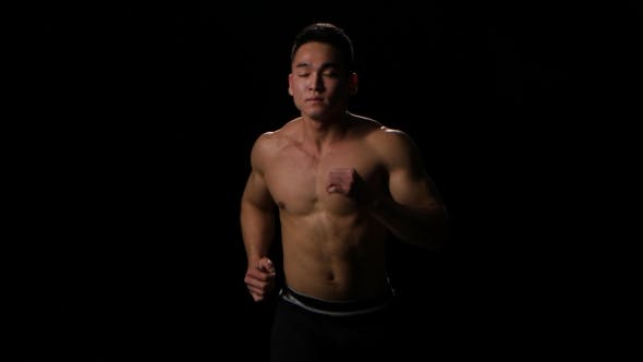 Thumbnail for Sportsman Running on Black Background at Fast Pace. Middle Distance