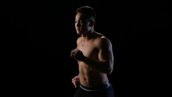 Thumbnail for Athlete Champion Run on Black Background. Middle Distance, Side View
