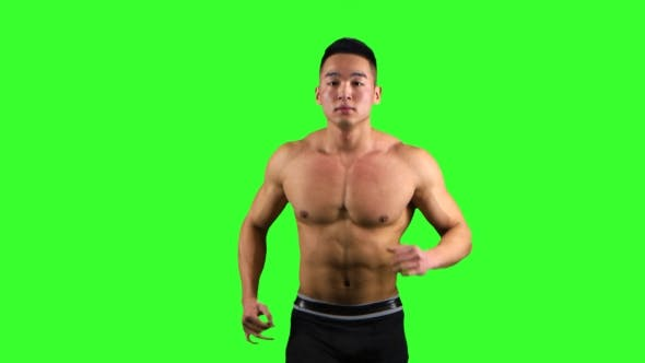 Thumbnail for Athlete Man Runs on the Green Screen Background. Front View