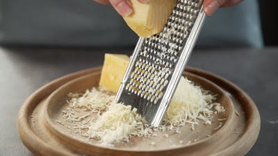 Chef Grates Cheese for Making Pie, Grated Cheese, Dishes From Cheese