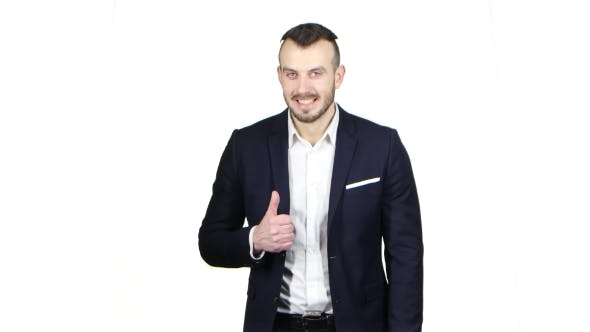 Thumbnail for Pleased Businessman Shows Gesture All Right, Thumbs Up. White Background