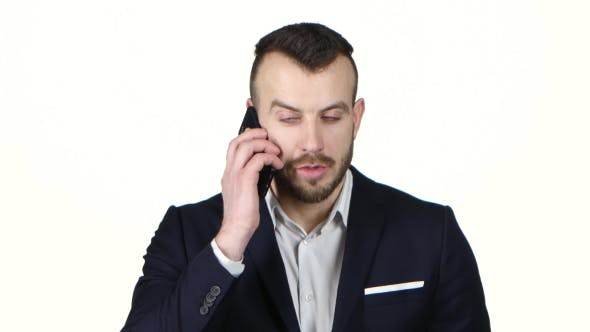 Thumbnail for Man in Business Suit Talking on Mobile Phone. White Background