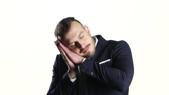 Thumbnail for Man Putting Two Hands Under His Head, Pretends Be Asleep
