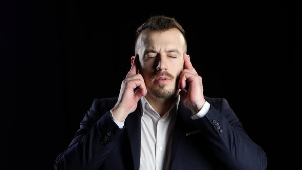 Thumbnail for Businessman in Black Suit Suffers From Headache and Does Massage