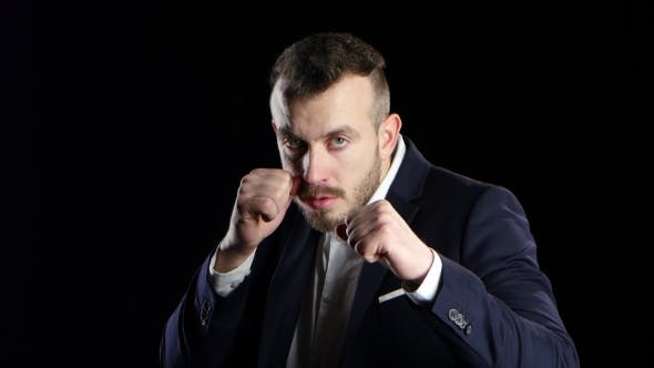 Thumbnail for Sportsman in Business Suit Is Boxing, Looks at the Camera