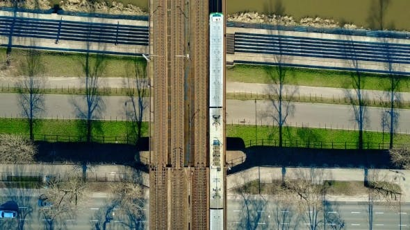 Thumbnail for Passenger Train Moving on Railway Bridge Across the River and Highway