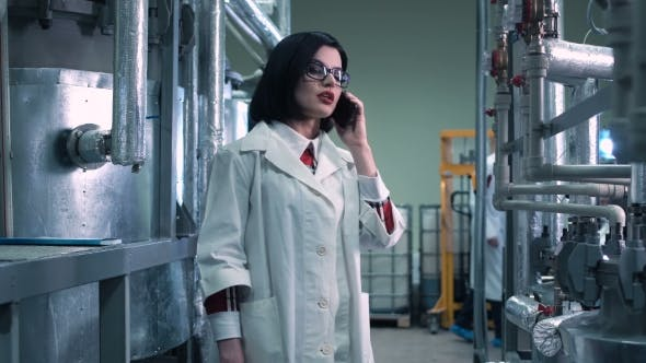 Thumbnail for Female Scientist Reporting on Her Phone in Lab