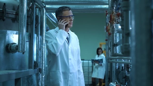 Thumbnail for Male Scientist Reporting on His Phone in Lab