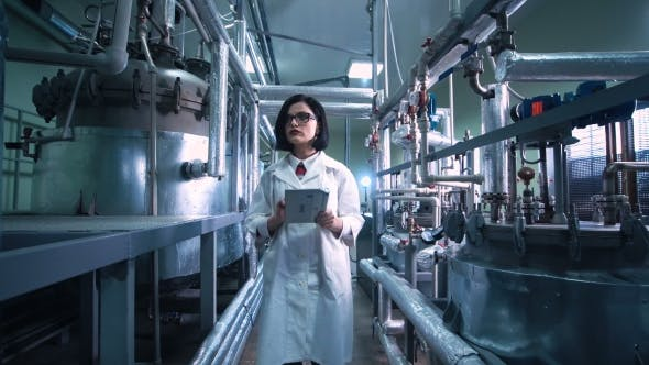 Thumbnail for Woman with the Tablet on Chemistry Factory