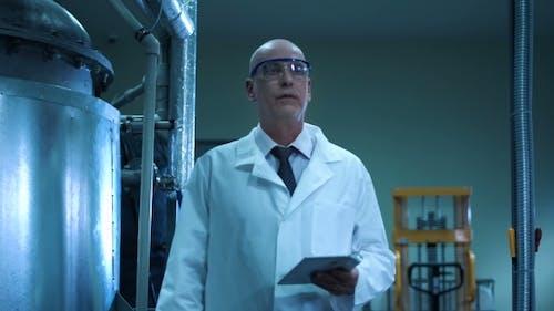 Scientist Touching the Valve
