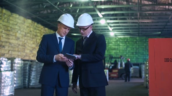 The Specialists Talking in Warehouse