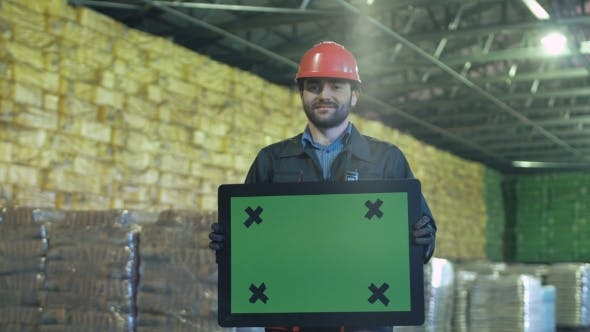 Thumbnail for Smiling Warehouse Worker with Chromakey Sign
