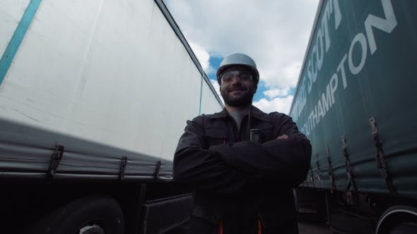 Thumbnail for Person Between Two Trucks Looking Camera