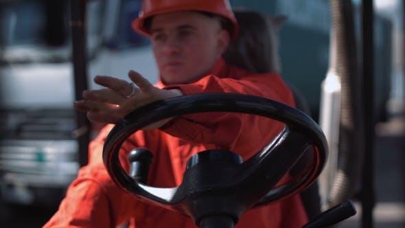 Thumbnail for Man Driving a Loading Car