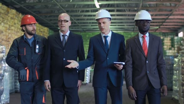 Businessmen Meeting in the Warehouse