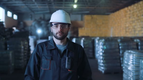 Thumbnail for Man Walking in Warehouse