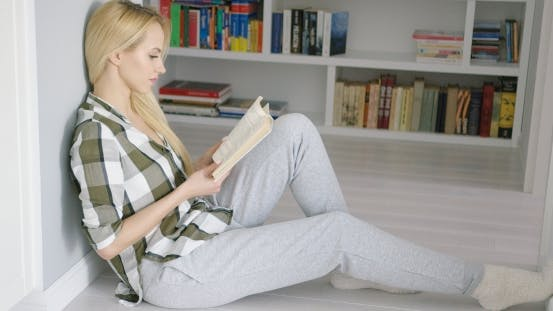 Thumbnail for Woman Sitting on Floor with Book