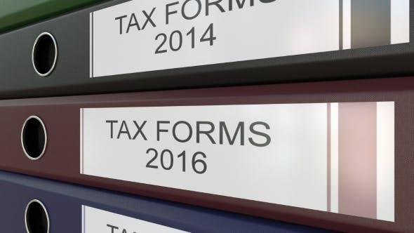 Office Binders with Tax Forms Tags Different Years